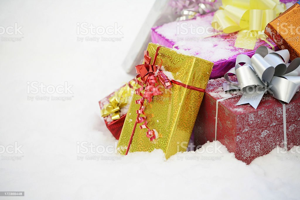 Christmas gifts in a snow royalty-free stock photo