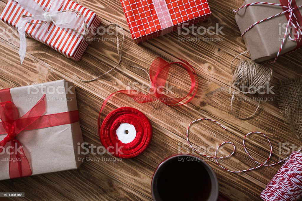 Christmas gifts in paper and tied with red Lizenzfreies stock-foto