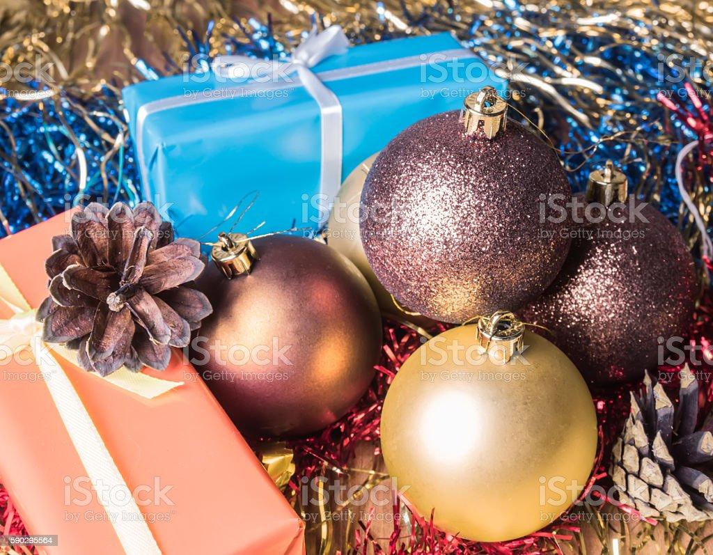 Christmas gifts lying among Christmas balls and Christmas tinsel royaltyfri bildbanksbilder