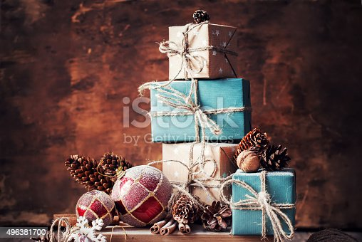 493890050 istock photo Christmas Gifts, Nuts, Fir Tree Toys on Wooden Background 496381700