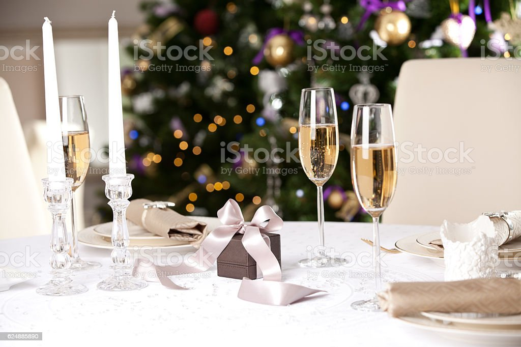 Christmas gifts on the beautiful table with Christmas tree on...