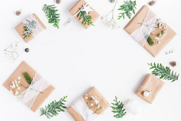 Christmas gifts on white background. Flat lay, top view stock photo