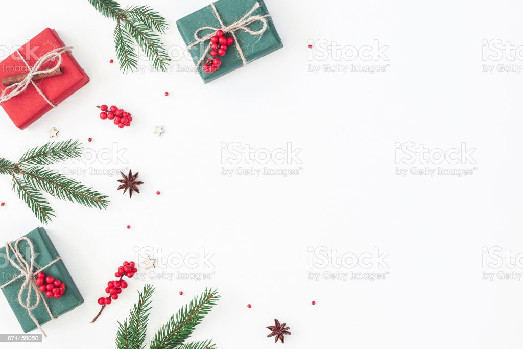 Christmas gifts on white background. Flat lay, top view