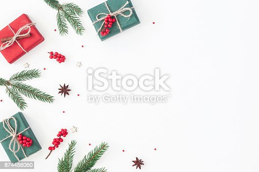 1060169304 istock photo Christmas gifts on white background. Flat lay, top view 874458050