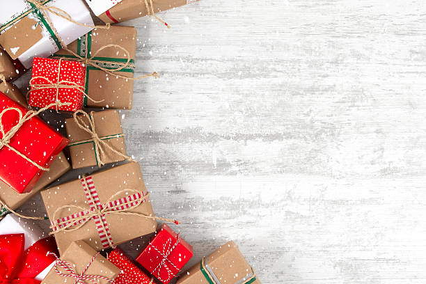 Christmas Gifts on Wooden Table stock photo
