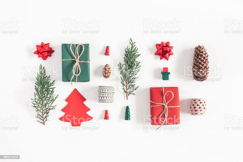 Christmas gifts, pine branches, toys. Flat lay, top view