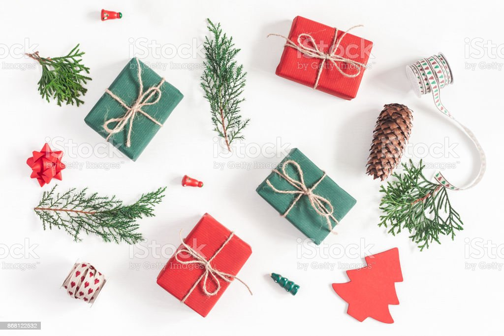 Christmas gifts, pine branches, toys. Flat lay, top view stock photo