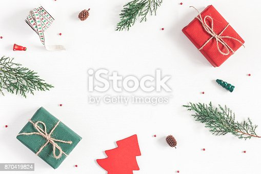 1060169304 istock photo Christmas gifts, pine branches, toys. Flat lay, top view 870419824