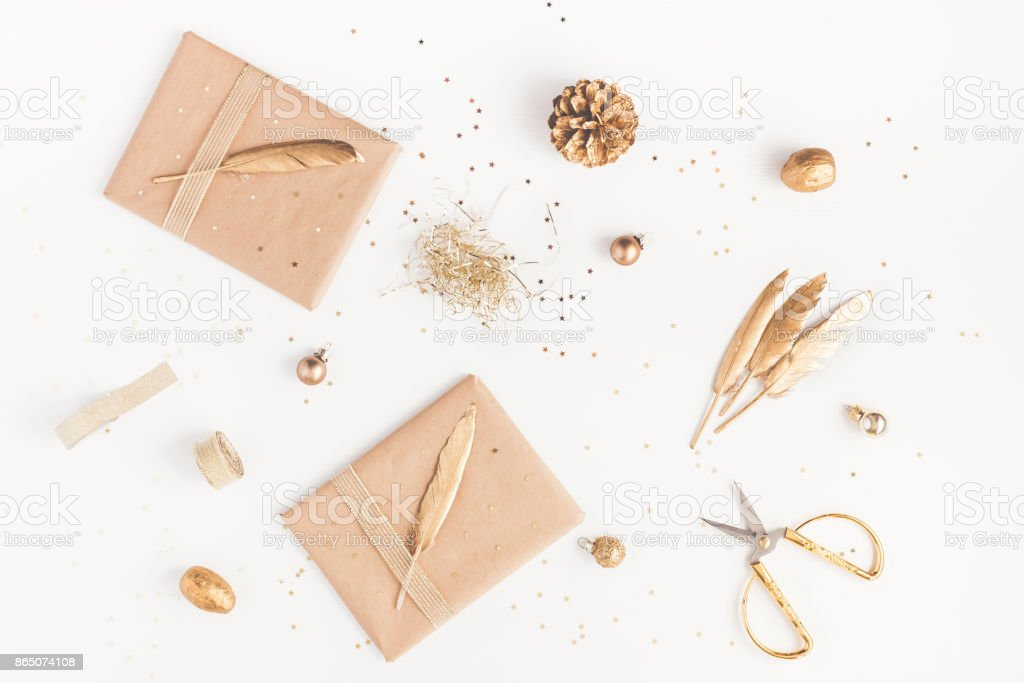 Christmas gifts, pine cone, golden decorations. Flat lay, top view