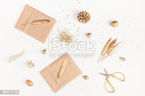 istock Christmas gifts, pine cone, golden decorations. Flat lay, top view 865074108