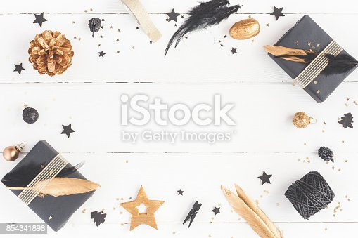 istock Christmas gifts, pine cones, decorations. Flat lay, top view 854341898