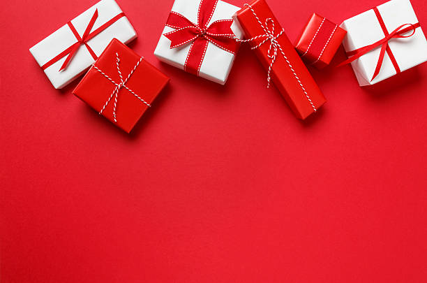 Christmas gifts presents simple classic red background border stock photo