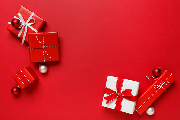 Christmas gifts presents simple classic red background stock photo