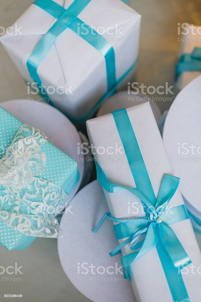 Christmas gifts under the decorated tree in blue stock photo