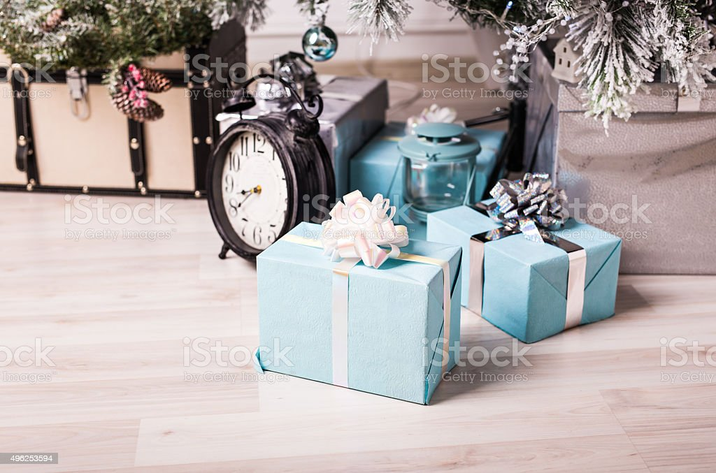 christmas gifts under tree stock photo