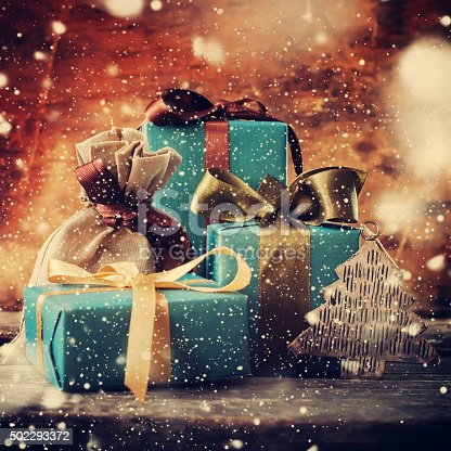 493890050istockphoto Christmas Gifts with Color Bows. Drawn Snowfall. Vintage 502293372