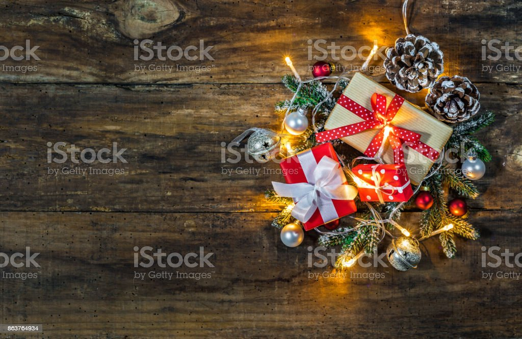 Christmas decoration with presents on wooden background.
