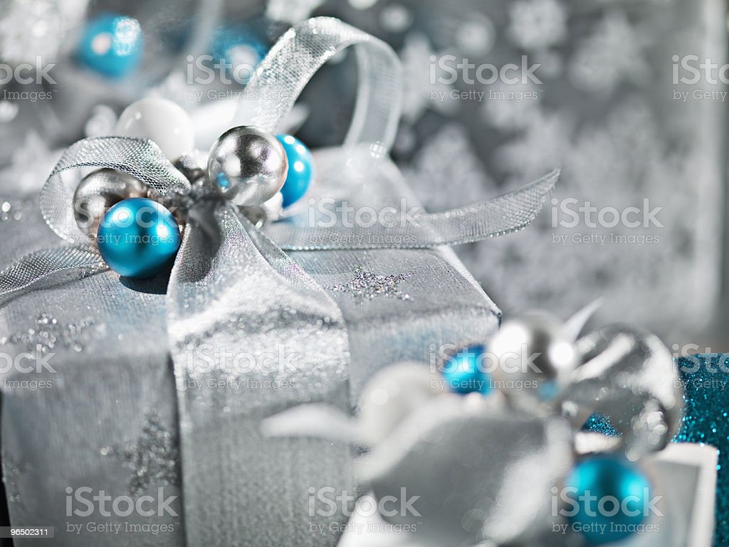 Christmas gifts with silver ribbon and wrapping royalty-free stock photo