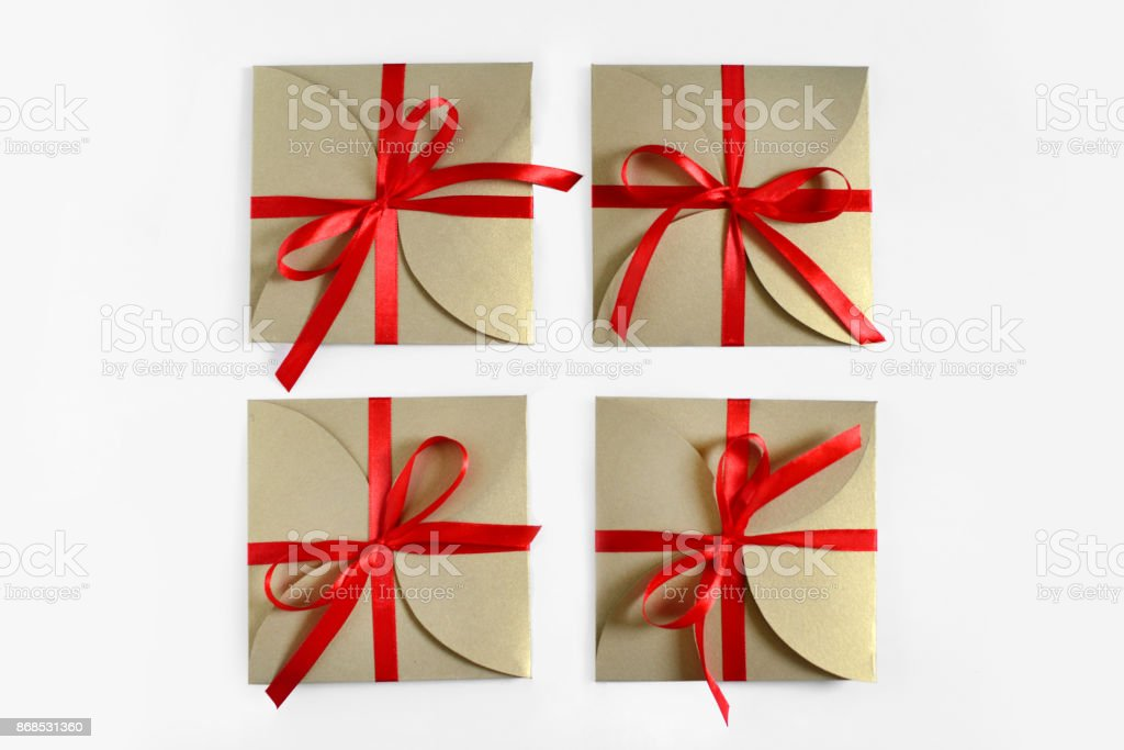 Christmas Gifts Wrapped In Brown Paper With The Bow Top View ...