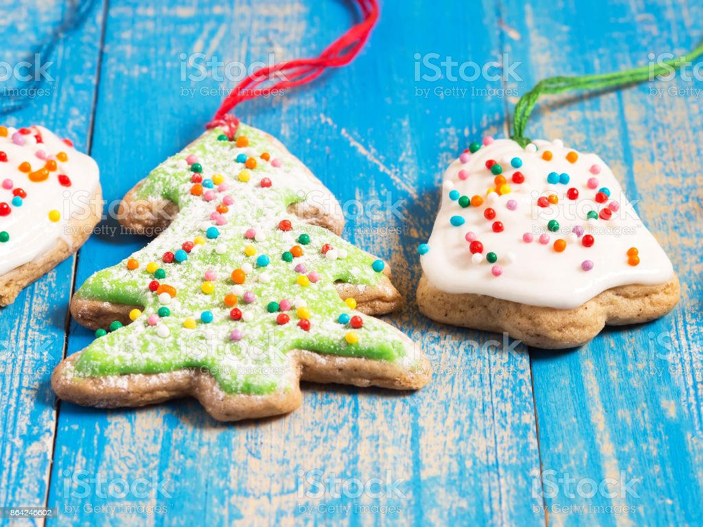 Christmas ginger biscuits with icing on a blue background. Closeup royalty-free stock photo