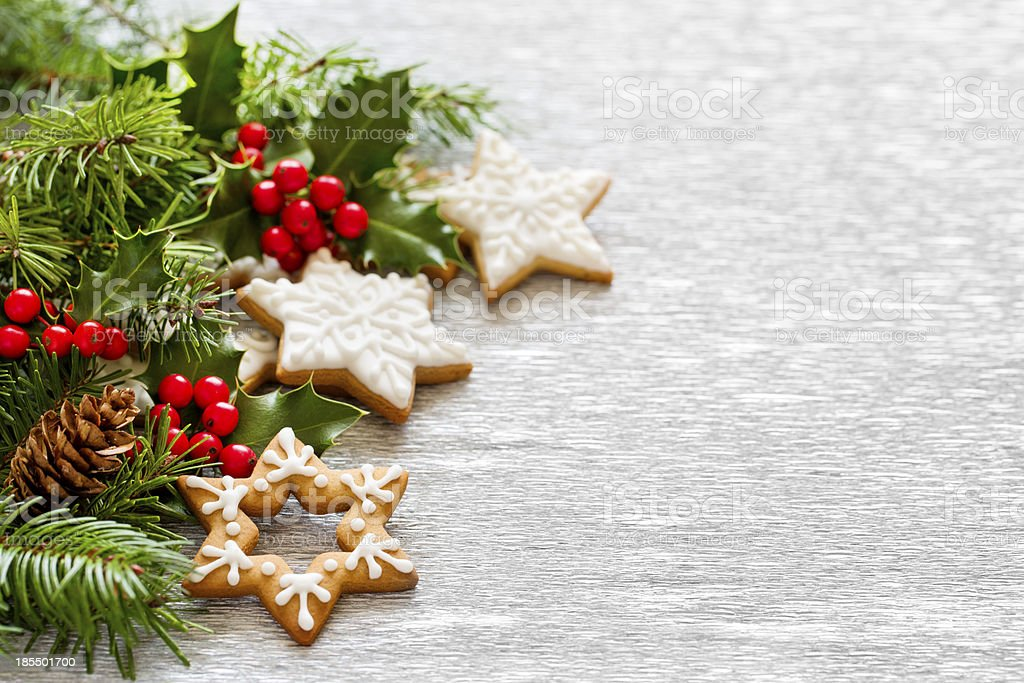 Christmas gingerbread and holly branch decoration stock photo