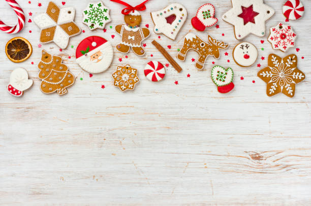 christmas gingerbread and sweets on wooden background with copy space - christmas cookies stock pictures, royalty-free photos & images