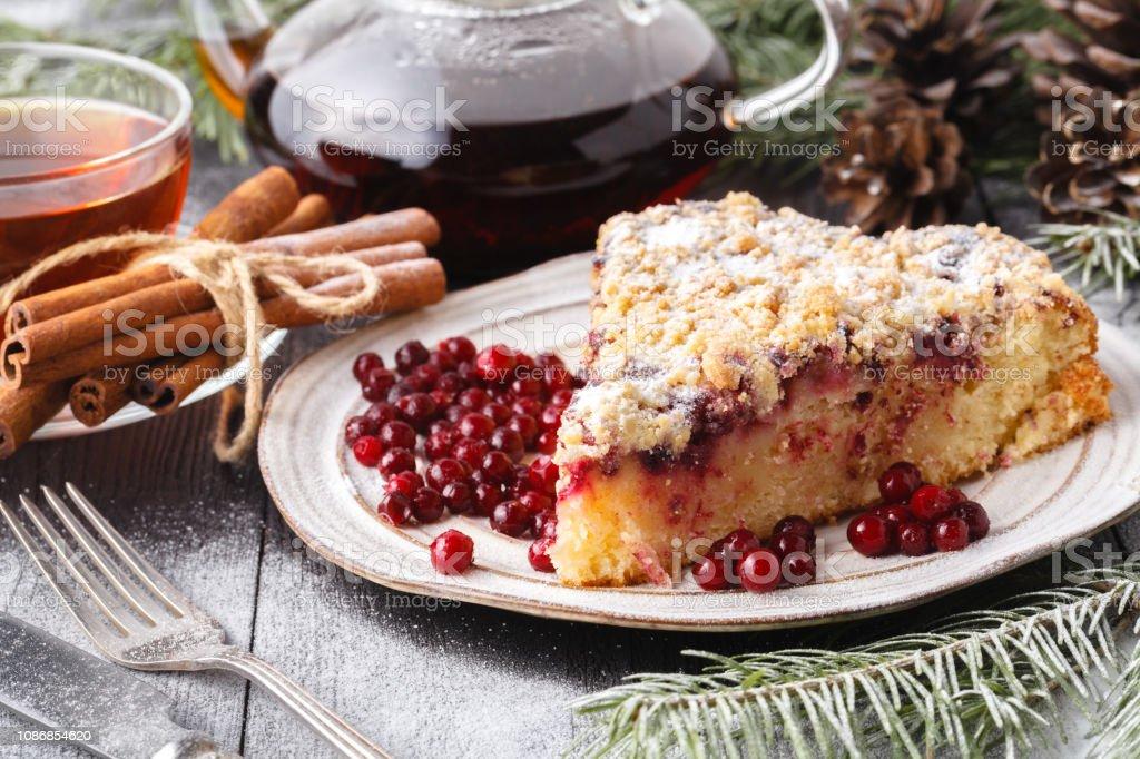 Christmas gingerbread cake among traditional decorations stock photo