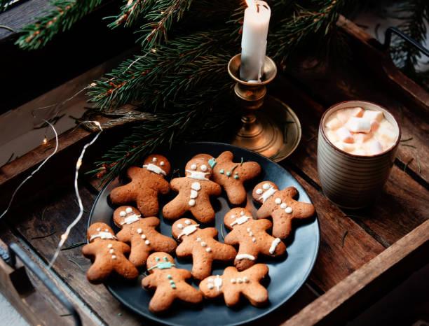 Christmas gingerbread cookies and mug of coffee on a tray stock photo