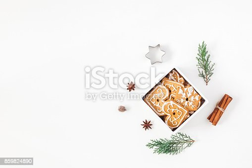 istock Christmas gingerbread cookies and pine branches. Flat lay, top view 859824890