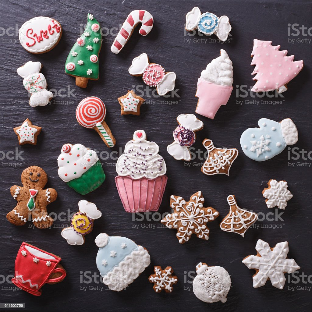 Christmas gingerbread cookies on a slate board closeup. top view stock photo