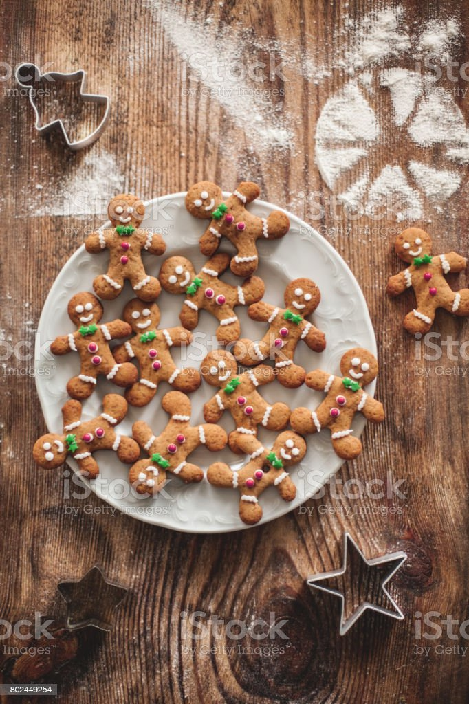 Christmas gingerbread cookies on a wooden table with molds. stock photo