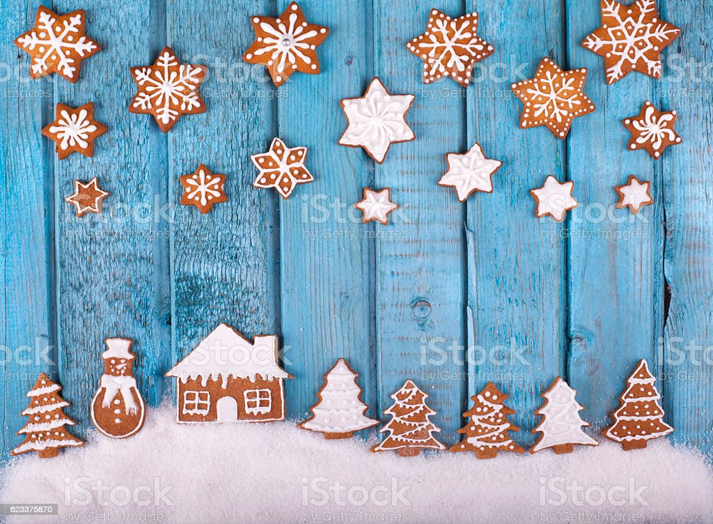 Christmas gingerbread cookies on blue vintage wooden table stock photo