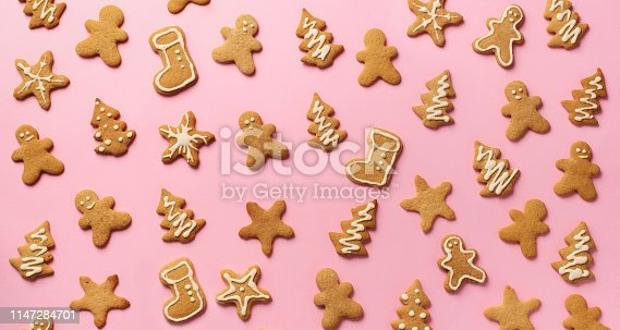 istock Christmas gingerbread cookies on pink background. Banner. Top view, copy space. New year concept 1147284701