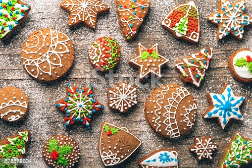 Christmas gingerbread cookies on wooden table with sugar