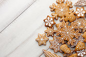 Christmas gingerbread cookies set on white wooden background, top view