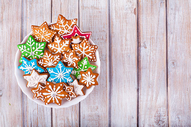 Christmas Gingerbread Cookies Stars on wooden table. Christmas Gingerbread Cookies Stars on wooden table. Used gingerbread cookies home-handedly made it from me. They are unique pieces and can not be found anywhere. sugar cookie stock pictures, royalty-free photos & images