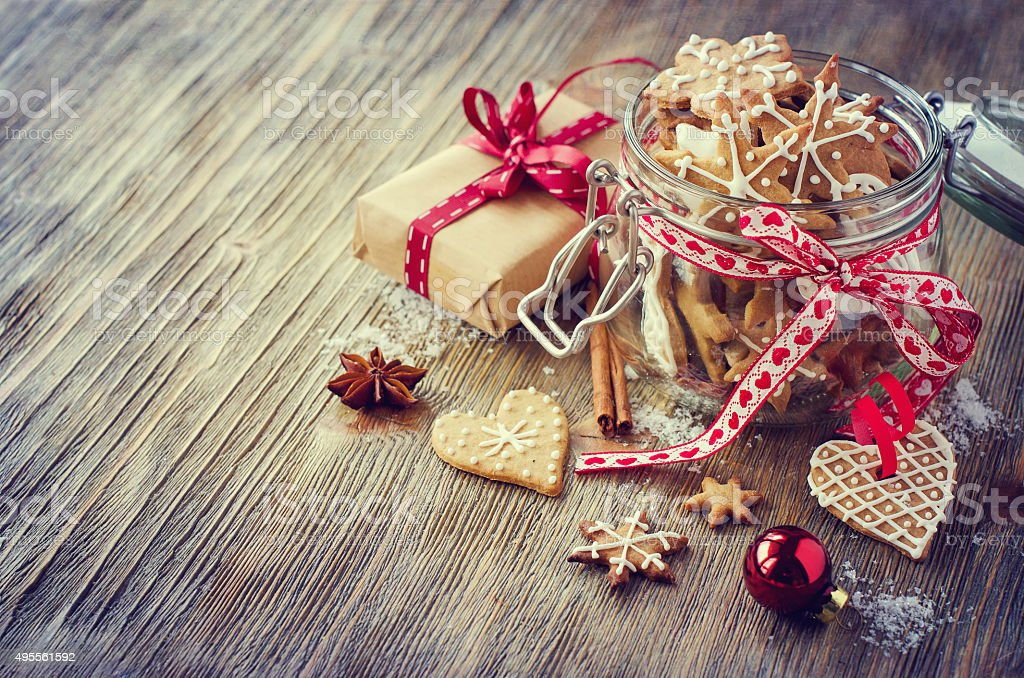 Christmas gingerbread cookies, vintage festive rustic table deco stock photo