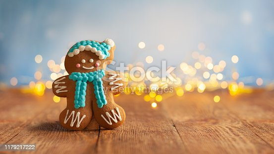 istock Christmas gingerbread cookies with Christmas decorations on wooden background 1179217222