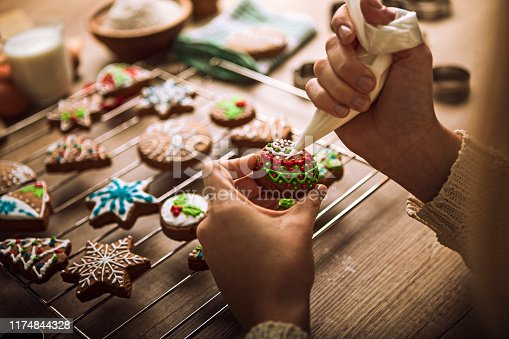 istock Christmas gingerbread cookies with tasty colorful sugar 1174844328