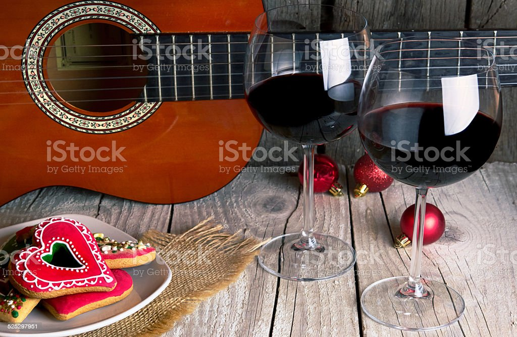christmas gingerbread guitar and Wine romantic new year background stock photo