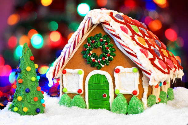Christmas gingerbread house against a colorful twinkling light background stock photo