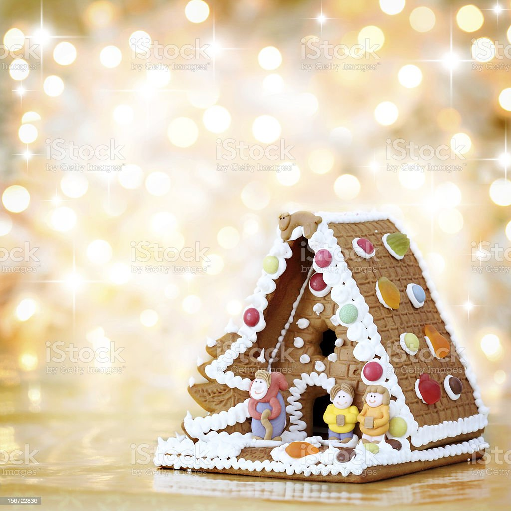 Christmas gingerbread house decoration on defocused lights background stock photo