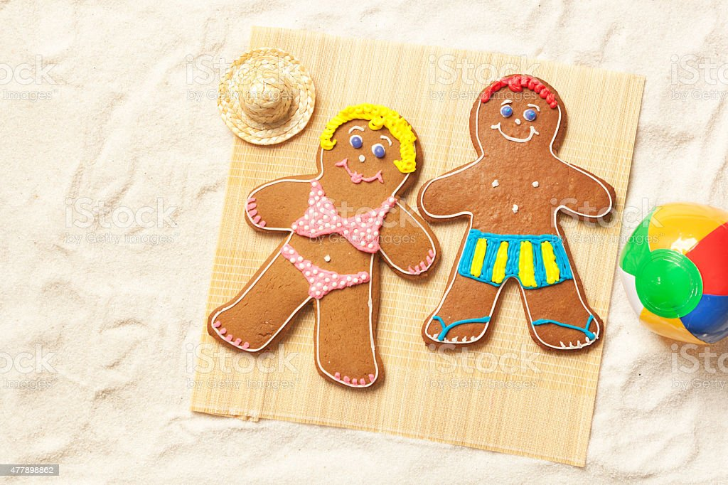 Christmas Gingerbread Man and Woman on Tropical Beach Winter Vacation stock photo