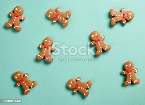 Gingerbread man cookies on green background.