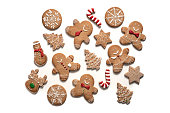 Christmas gingerbread man cookies, snowman, stars, snowflake, candy cane, reindeer and fir trees isolated on white background