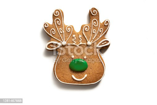istock Christmas gingerbread reindeer cookie isolated on white background 1281467668