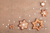 Christmas gingerbread star cookies with copy space on baking sheet. The cookies are homemade made by me and are unique and can not be found anywhere.