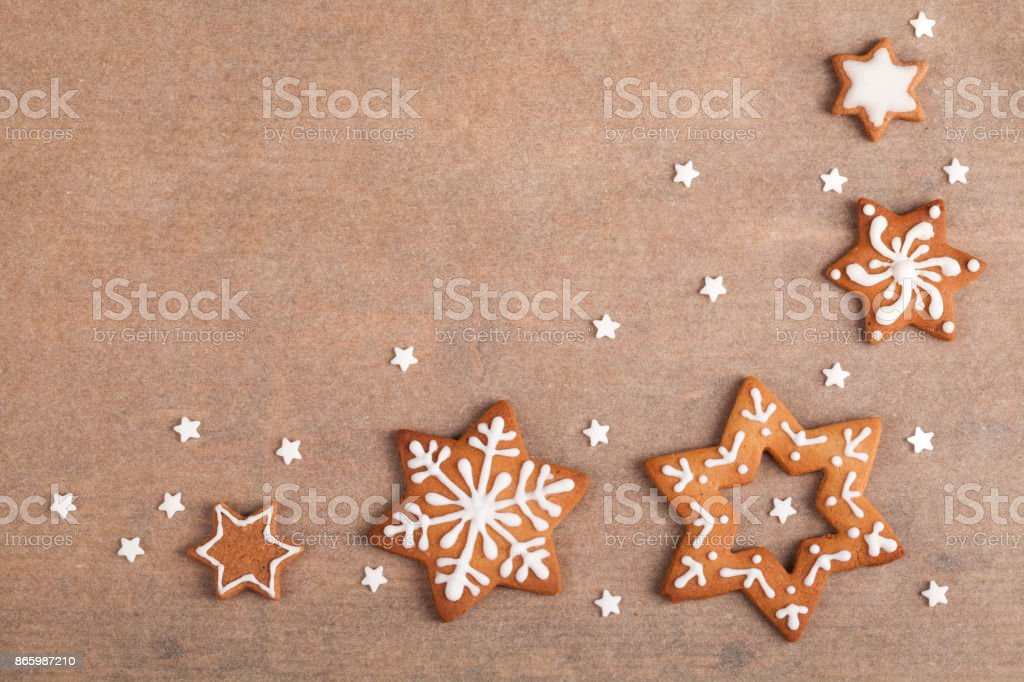 Christmas gingerbread star cookies with copy space on baking sheet stock photo