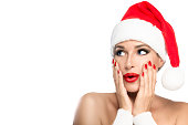Christmas Girl. Gorgeous young woman in a Santa hat