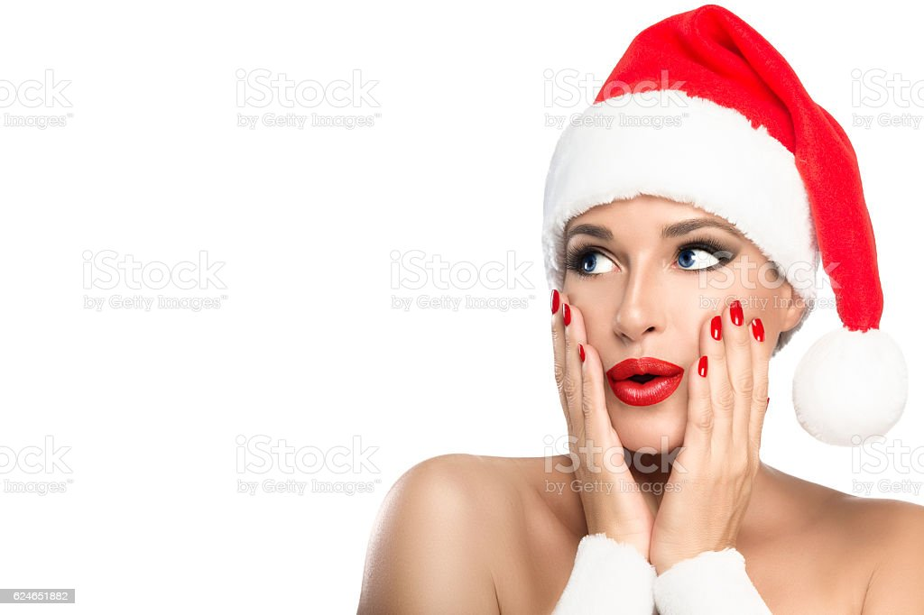 Christmas Girl. Gorgeous young woman in a Santa hat stock photo